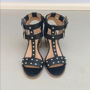Express heeled  black leather sandals. Size 6.